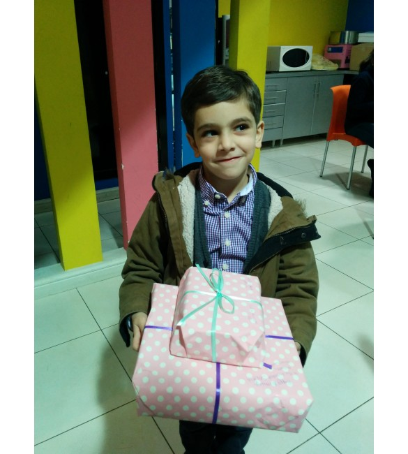 Faisal Ibrahim delivering gifts for his friend